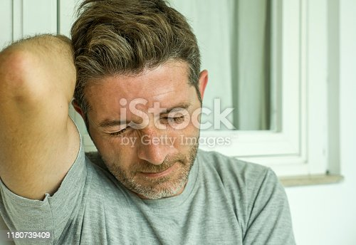 584608574 istock photo dramatic portrait of middle aged sad and depressed man in pain feeling stressed and frustrated suffering depression problem and anxiety crisis looking desperate and gloomy 1180739409