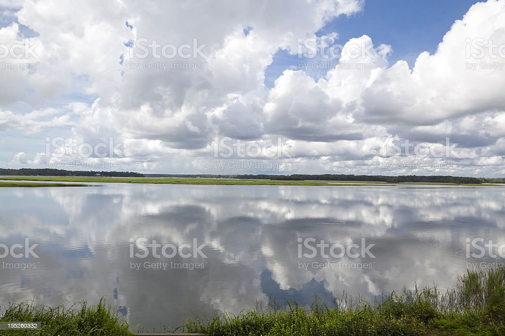 Dramatic Puffy White Clouds Reflected Smooth May River Bluffton SC stock photo
