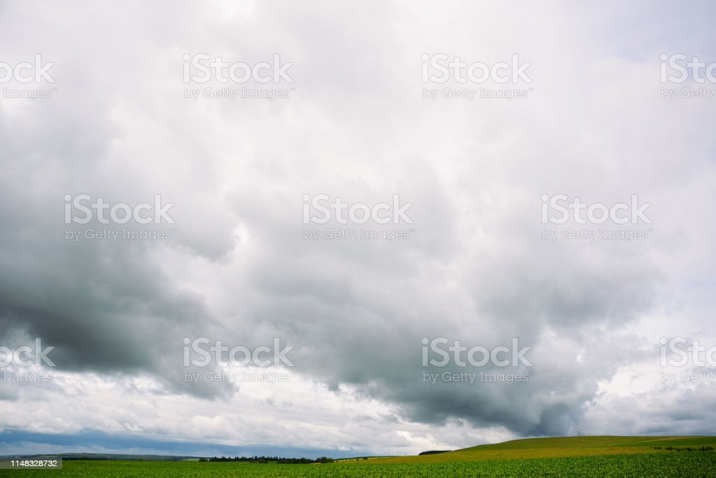 rainy dramatic sky clouds rural landscape, bad weather in summer,...