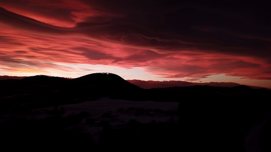 483422527 istock photo Dramatic red sunset in winter mountains 1203714683