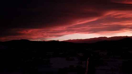 483422527 istock photo Dramatic red sunset in winter mountains 1203714689