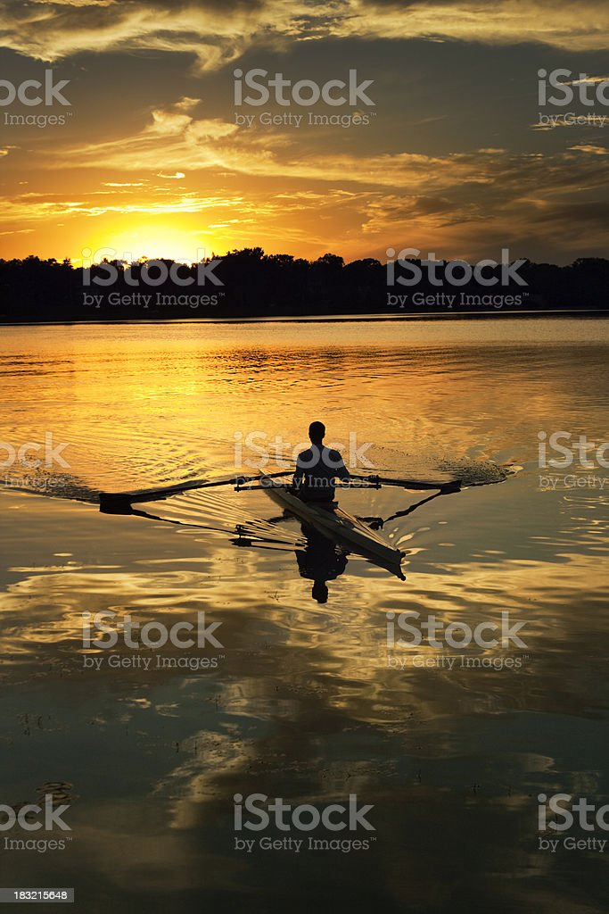 Dramatic Reflection, Sunset Sculling, Lake of the Isles, Minneapolis, Minnesota royalty-free stock photo