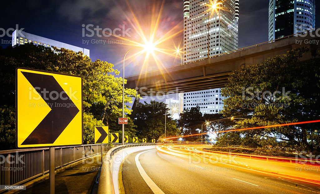 Dramatic Road Curve Illumionate At Night stock photo