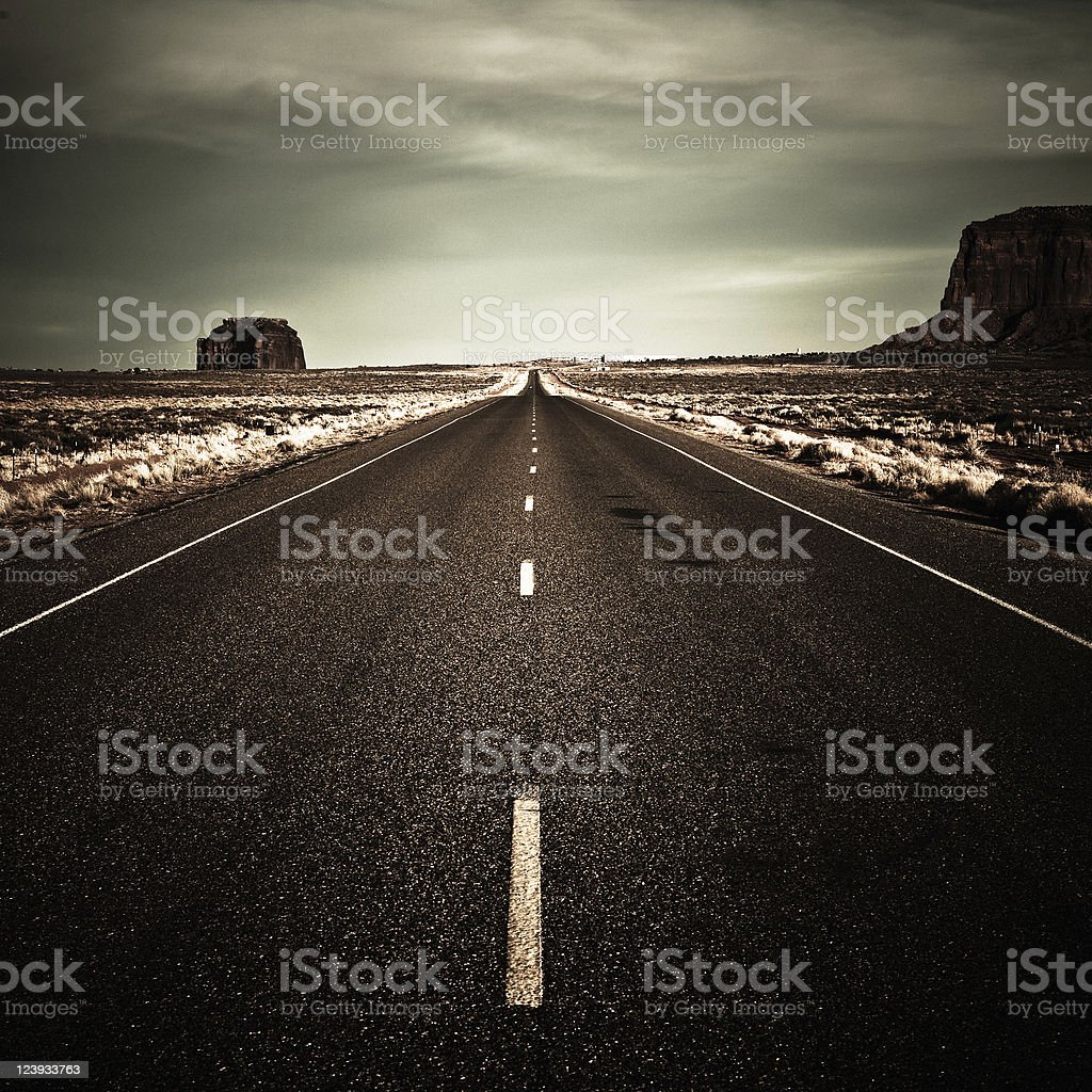 Dramatic Road in the Desert with Moody Sky, Monument Valley stock photo