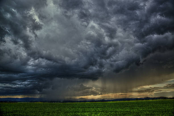 dramatic scene - meadow with clouds and rain – Foto