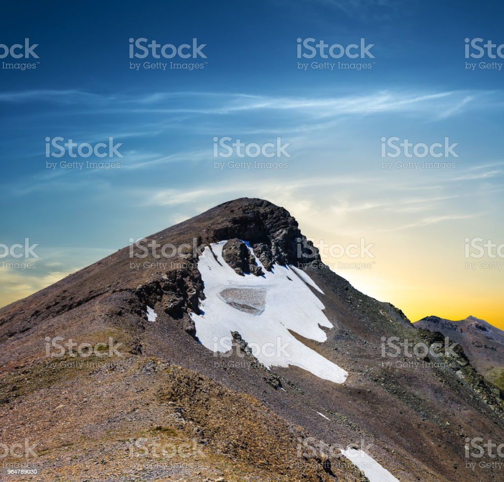 dramatic scene, mount top on a sunset background royalty-free stock photo