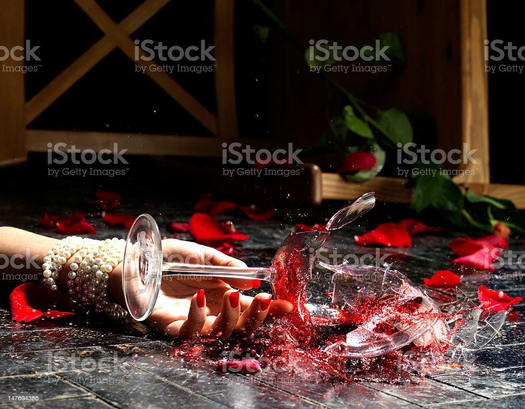 Dramatic scene of broken wineglass in dynamic. stock photo