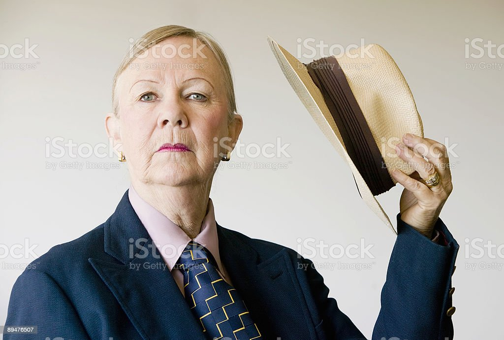 Dramatic Senior Woman with a Hat stock photo