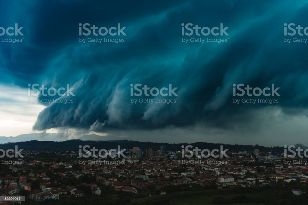 Dramatic shelf cloud over city stock photo