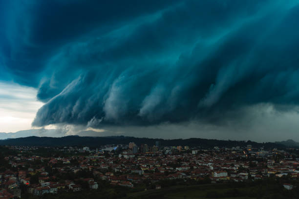 Dramatic shelf cloud over city panoramic shot of dramatic storm cloud over city, Slovenia approaching stock pictures, royalty-free photos & images