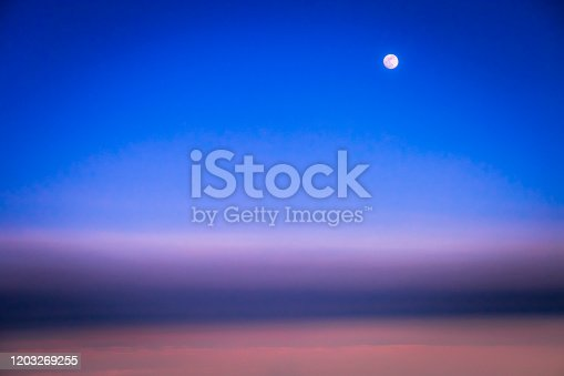 1045890176 istock photo Dramatic Sky above clouds and full moon from airplane window – Usa, North America 1203269255