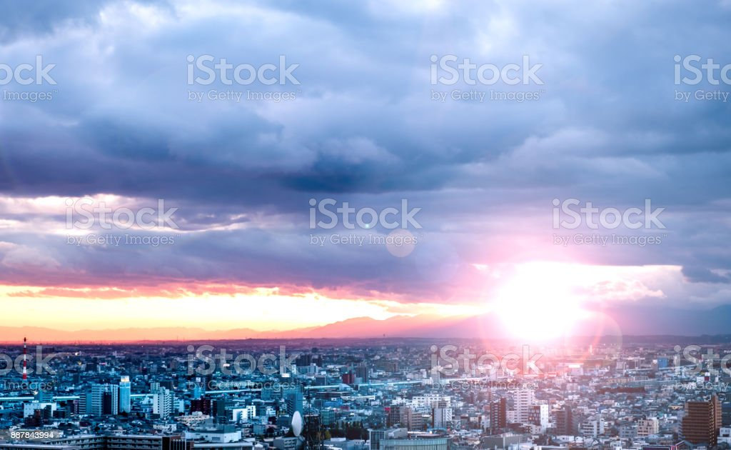 Dramatic sky and cityscape in the morning stock photo