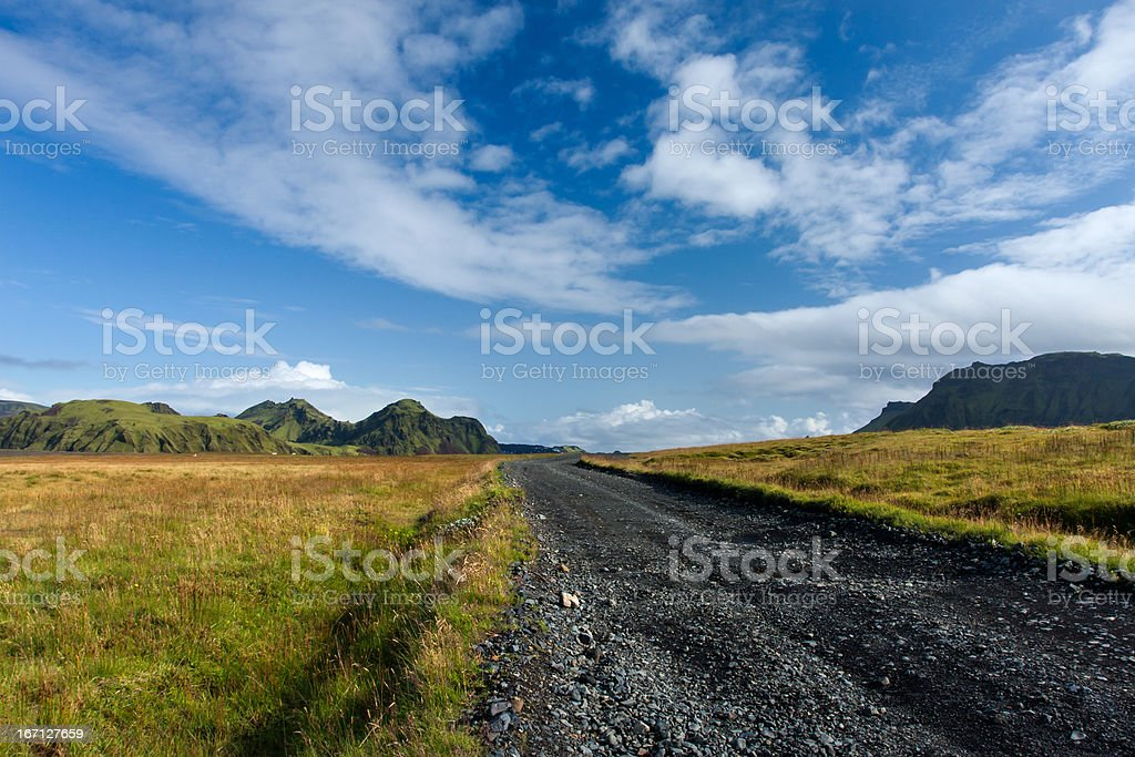 Dramatic Sky and road in the Icelandic mountains royalty-free stock photo