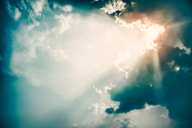 Dramatic Sky and Sun Rays Background. Toned Photo. - Photo