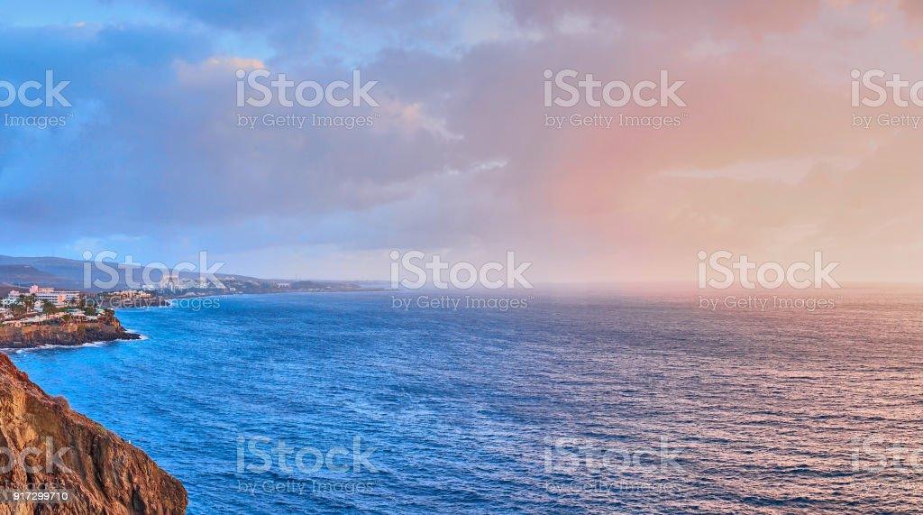 Dramatic sky at sunset over ocean stock photo