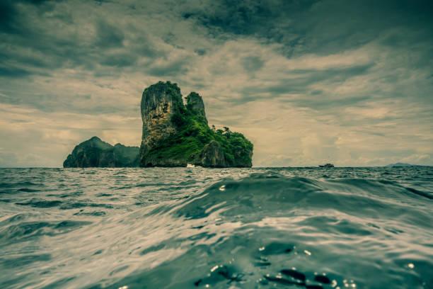 dramatic sky, bida islands, phi phi, krabi, thailand - desert island stock photos and pictures