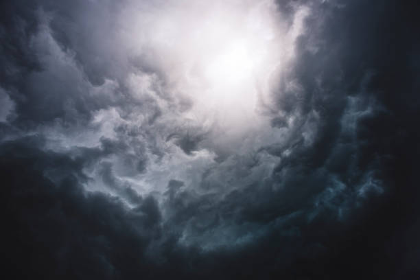Dramatic Sky Bright Hole View on storm clouds from the ground, forming powerful thunderstorm. altocumulus stock pictures, royalty-free photos & images