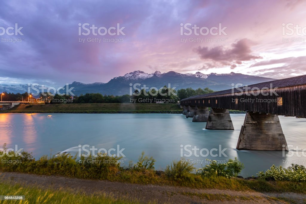 Dramatic sky in the mountains. Bridge across the Rhine. Liechtenstein royalty-free stock photo