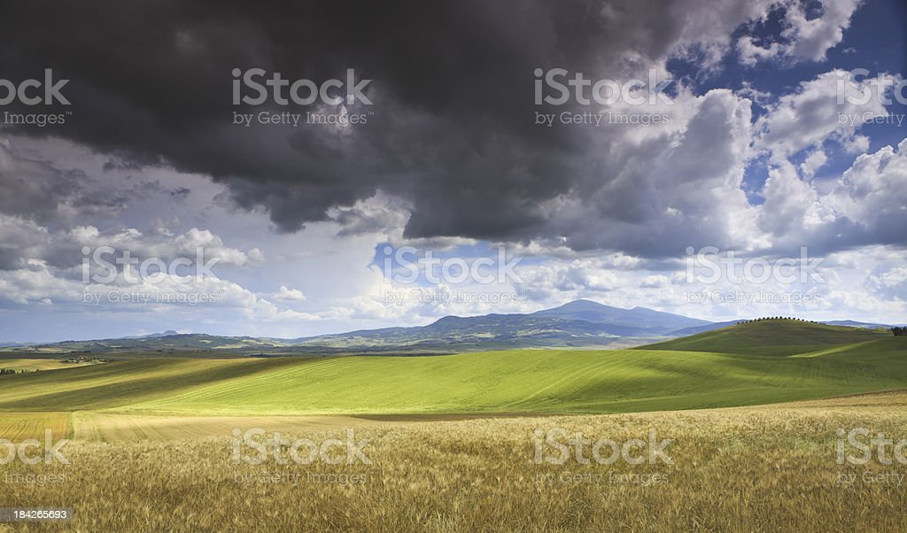 Dramatic sky in Val d'Orcia, Tuscany Italy royalty-free stock photo