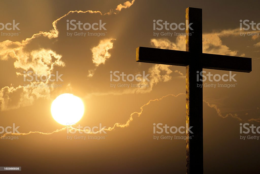Dramatic Sky Orange Clouds Bright Yellow Sun Large Christian Cross royalty-free stock photo