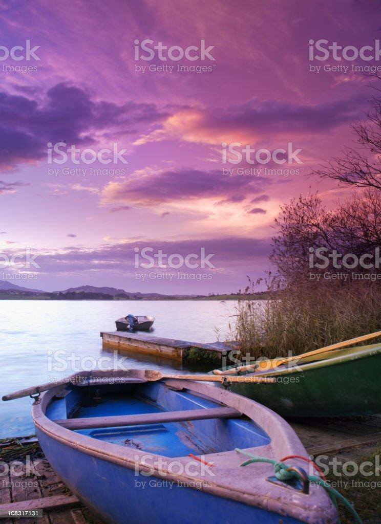 dramatic sky over a boat, bavaria, allgau stock photo
