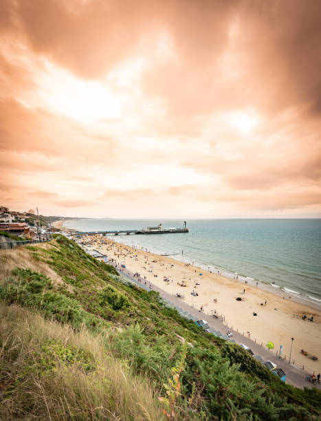 Dramatic sky over Bournemouth pier and beach stock photo