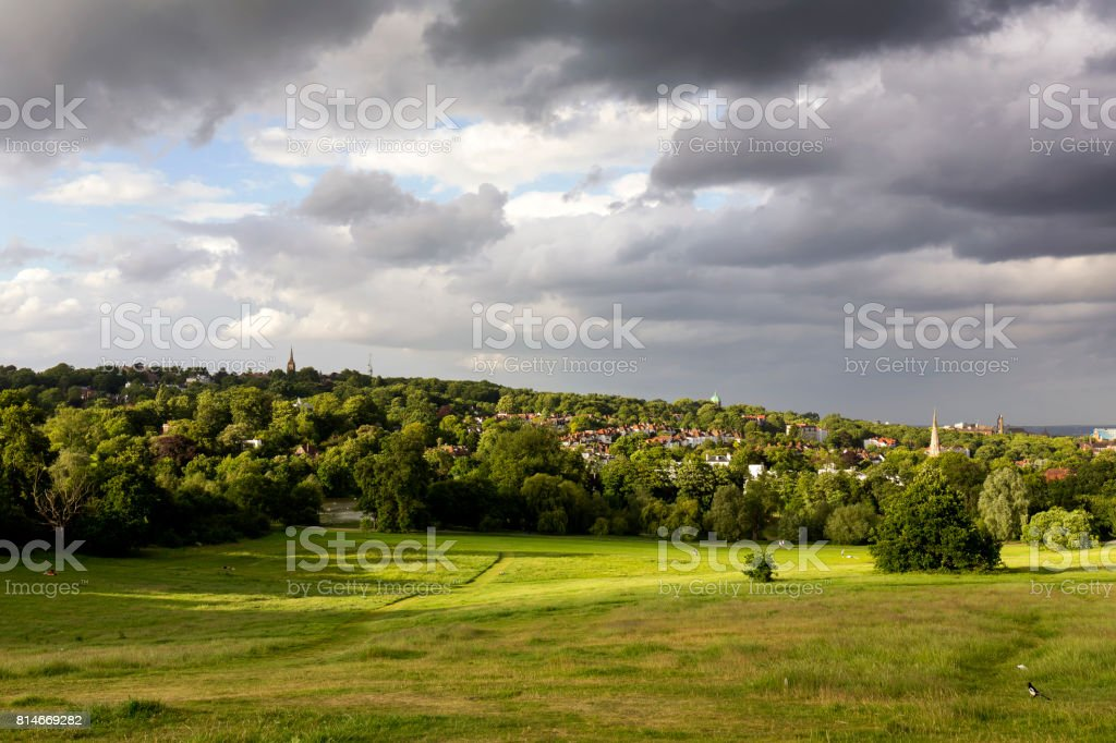 Dramatic sky over Highgate Village seen from Parliament Hill at sunset stock photo