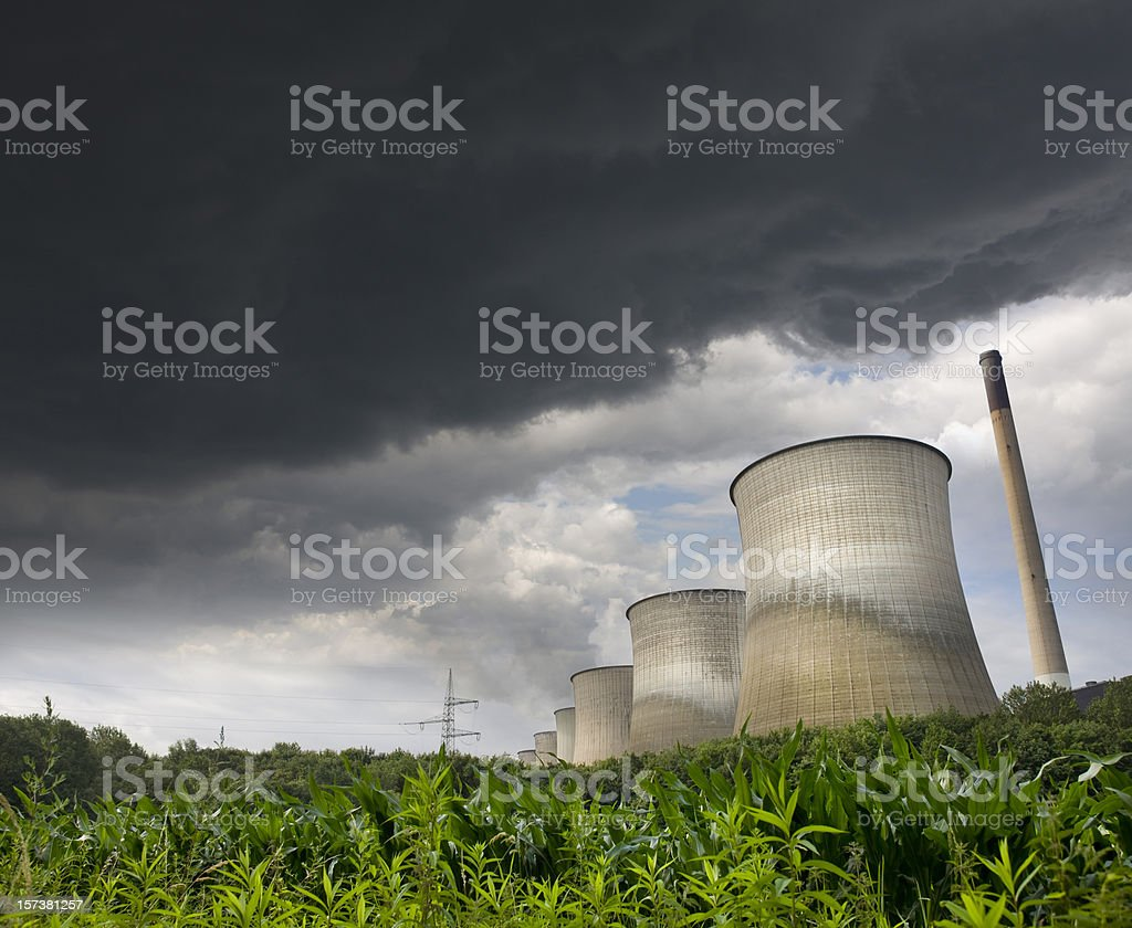 Dramatic sky over power station royalty-free stock photo