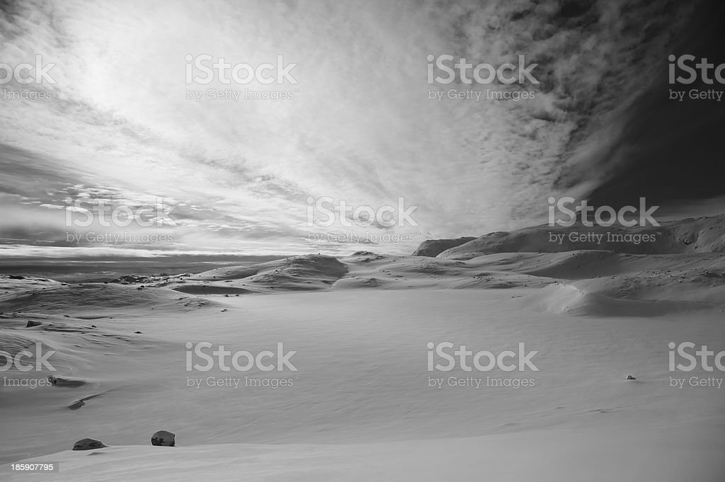 Dramatic sky over snow-covered high Norwegian mountains in winter stock photo