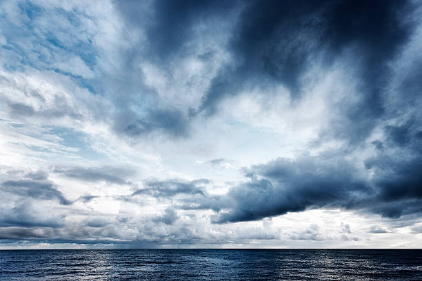 """Dramatic sky over the sea """"Imposing grey clouds over a calm sea, Dorset, UK"""" passion stock pictures, royalty-free photos & images"""