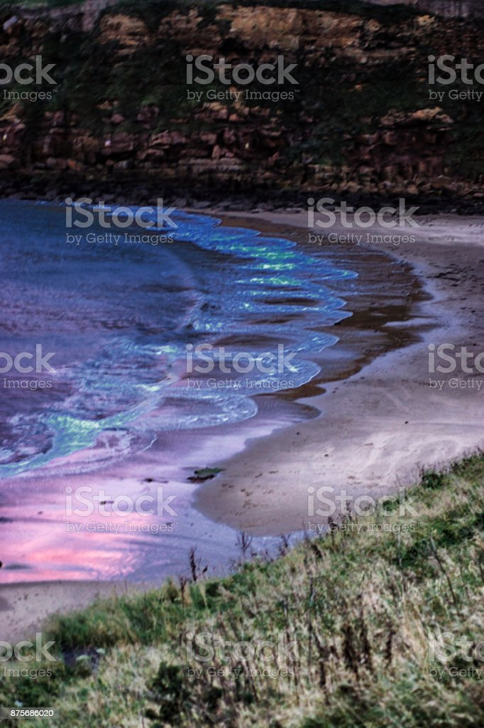 Dramatic sky reflected in waves stock photo