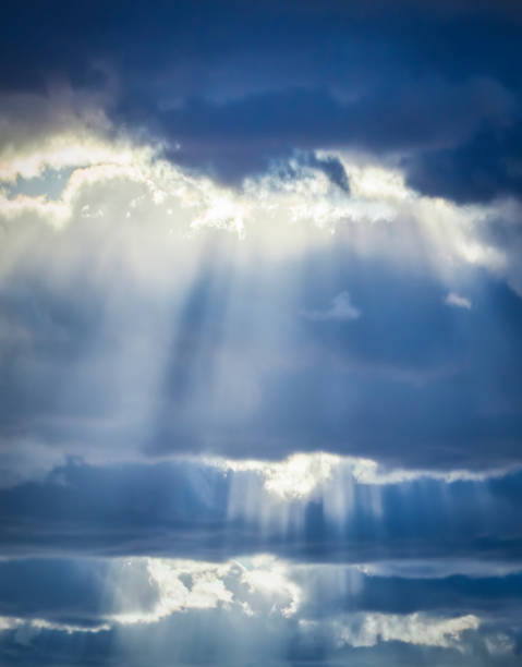 Dramatic sky. The sun's rays among the clouds. stock photo