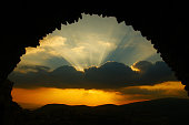 dramatic sky. view from an ancient arch in Israel on dramatic sky clouds
