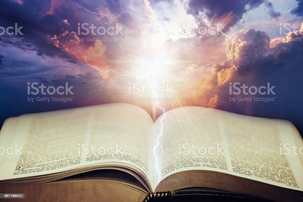Dramatic sky with open Bible stock photo