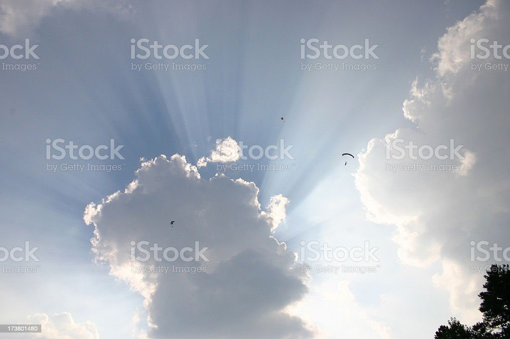 Dramatic Sky with Skydivers royalty-free stock photo