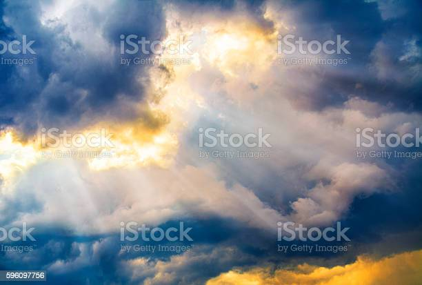 Photo of Dramatic sky with sun beams coming through the clouds