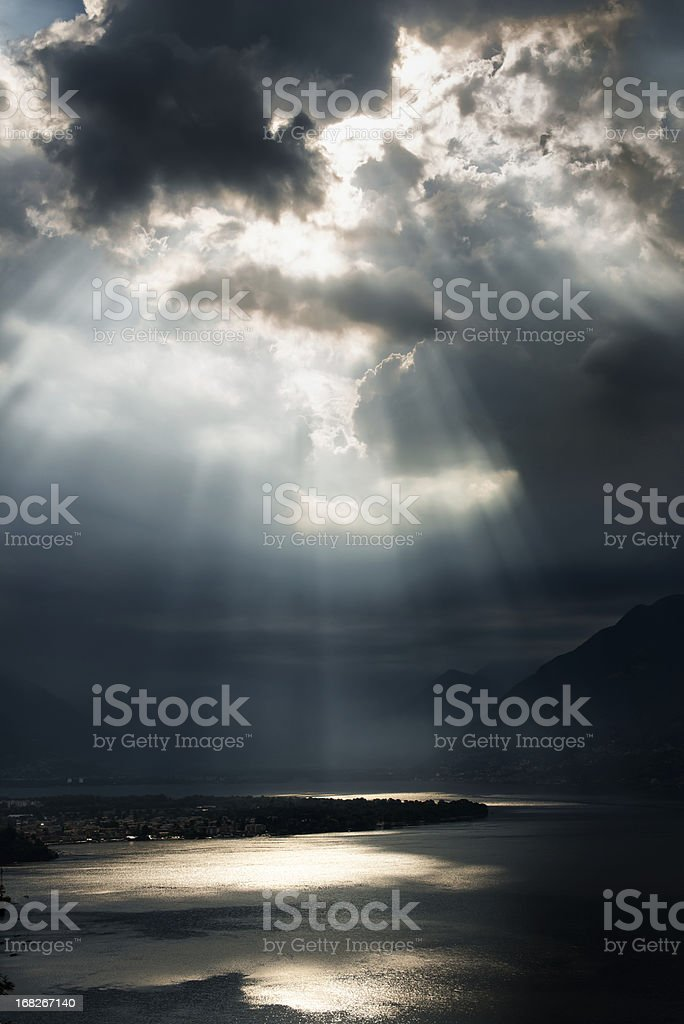 dramatic sky with sunbeams over Lago Maggiore, Switzerland royalty-free stock photo