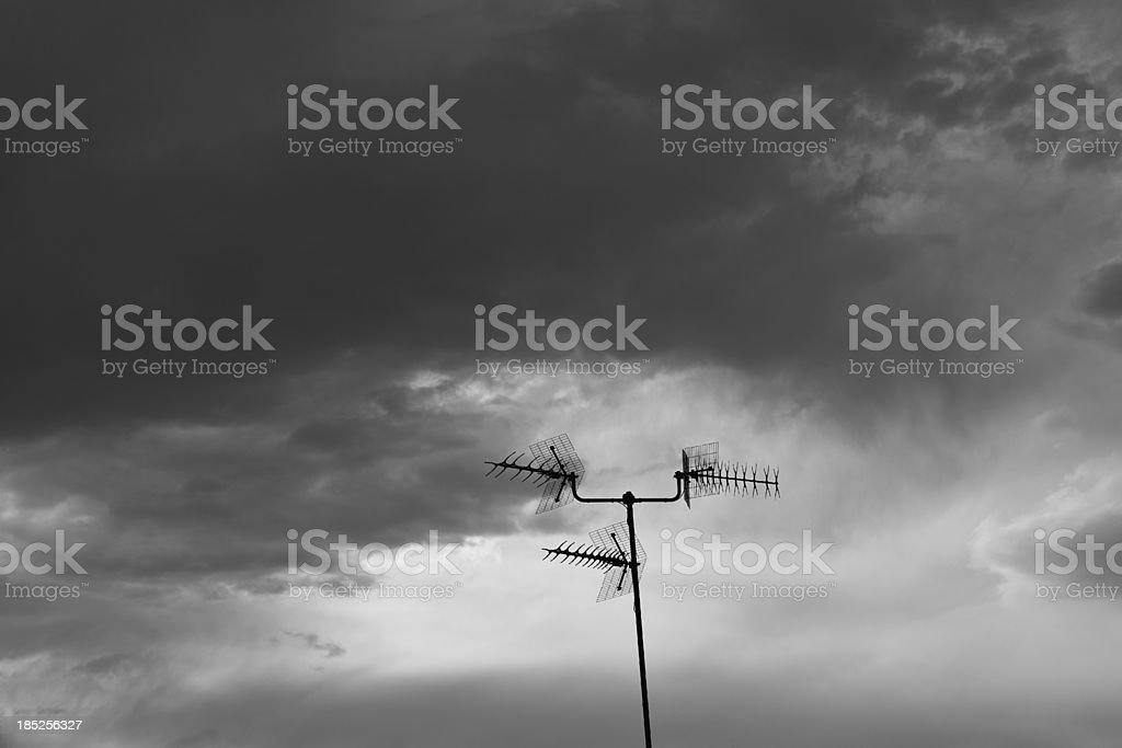 dramatic sky with tv antenna royalty-free stock photo