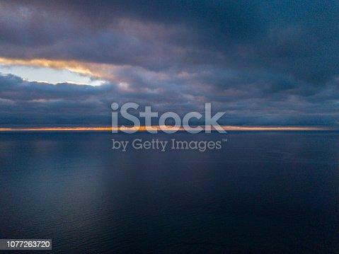 516351793 istock photo Dramatic skyline at dawn, Playa Del Ingles, Gran Canaria, Spain. 1077263720