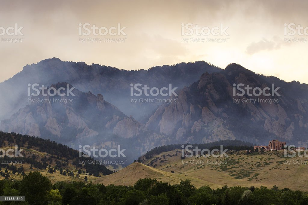 Dramatic Smoke and Fog Mountain Scene stock photo