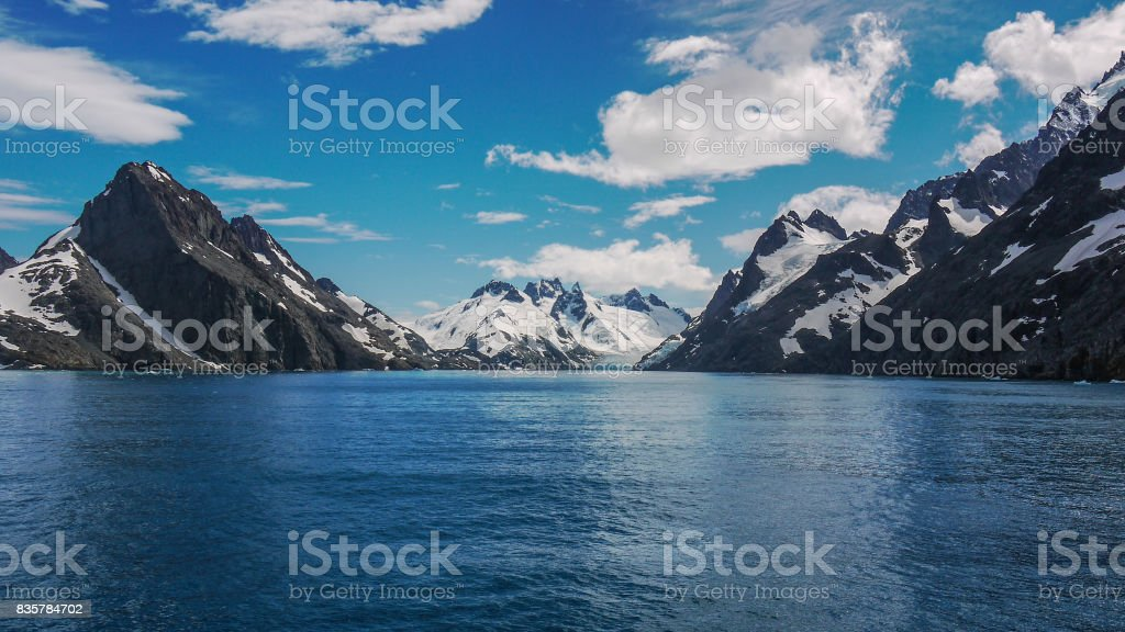 Dramatic snow covered mountainous landscape of Drygalski Fjord in southeastern South Georgia Island in the South Atlantic Ocean. stock photo