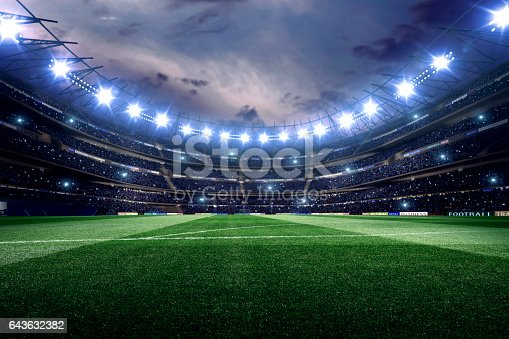 Dramatic soccer stadium with bleachers full of people. Grass, lights stadium, and all other elements are made in 3D.