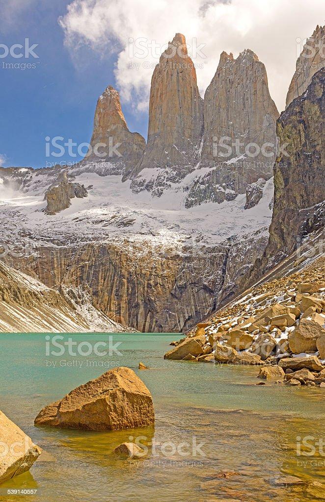 Dramatic Spires Above an Alpine Lake stock photo