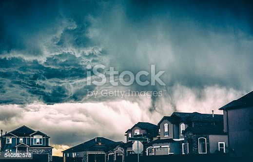 Dramatic storm clouds over residential neighborhood. Colorado, USA