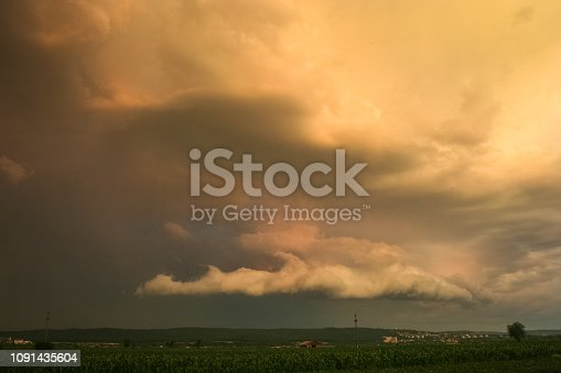 1039163636istockphoto Dramatic storm clouds over the transylvanian landscape. 1091435604