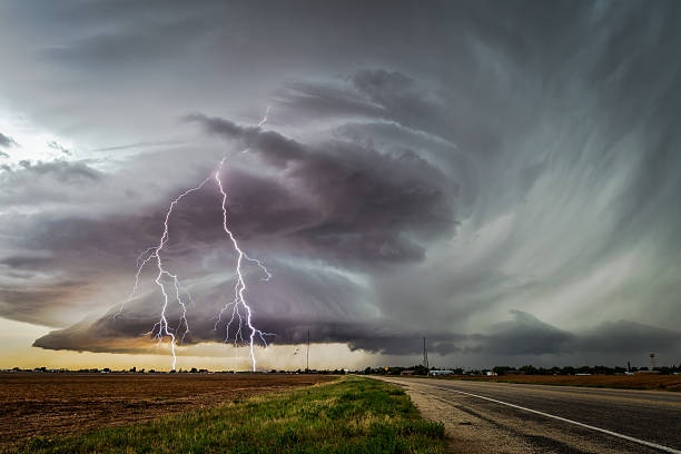 dramatic storm with forked lightning - extreme weather stock pictures, royalty-free photos & images