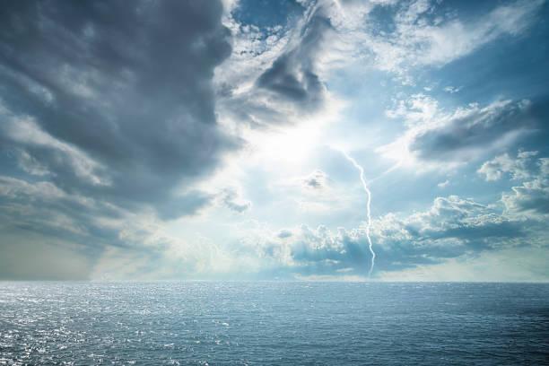 Dramatic stormy dark cloudy sky over ocean stock photo