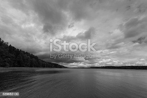 1159605033 istock photo Dramatic stormy sky over lake 539683130