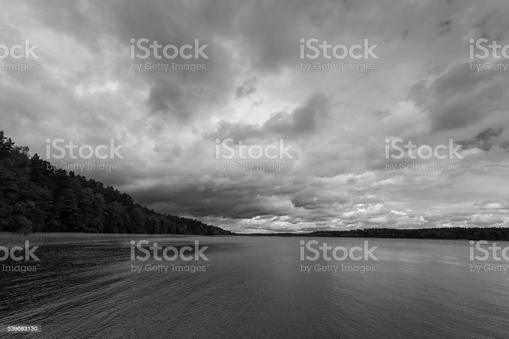 Dramatic stormy sky over lake stock photo