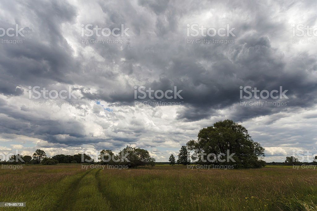 Dramatic stormy sky over meadow royalty-free stock photo